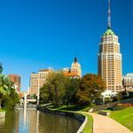The skyline and a river walk path in San Antonio, Texas