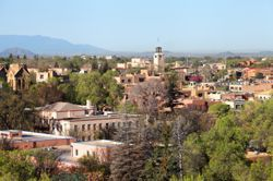 Sante Fe, NM (New Mexico) seen with trees and vegetation throughout the city