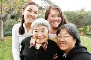 Elderly asian woman enjoying senior independent living pictured with family