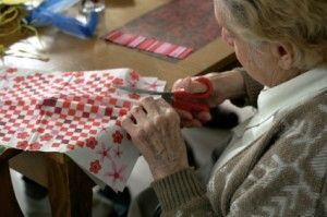 Senior doing crafts at an assisted living community