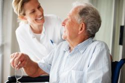 Man with Caregiver at Layton Terrace - Greenfield, WI