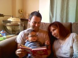 Joan, Mark and Oliver reading a book in Los Angeles, CA