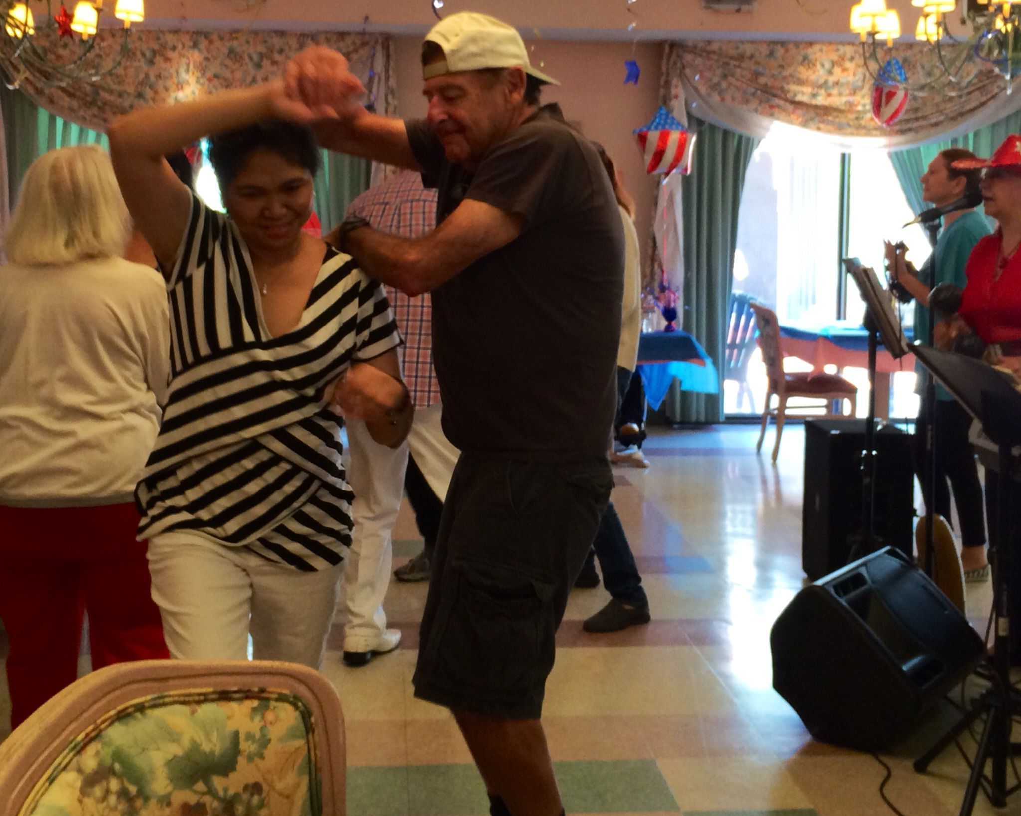 Joan's Journey - HVE Resident dances with aide on July 4
