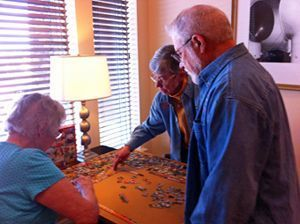 Margery's friends work on a puzzle